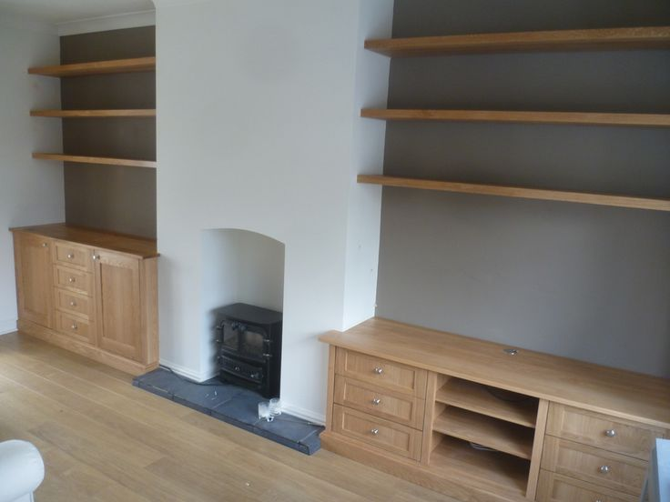 The look of solid oak is nice and I like the idea of a low run of cupboards (that could be sat on perhaps?) with feature shelves above. Either straight floating shelves or something that has mixed sizes and shapes. Also interesting to have low cupboards on one side of the chimney breast and taller ones on the other.
