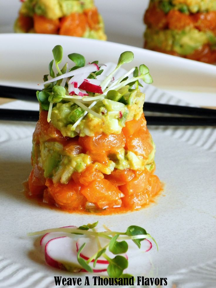 Sriracha Salmon Ceviche Towers with Garden Guacamole & Radish  Sprouts  -  refreshing with a true melody of flavors & textures from spicy, tangy to creamy & smooth with the kick & crunch from the radish & cucumber. I heart this!