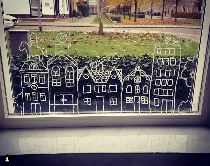 Huizen I + Sint op dak #raamtekening door Angelina C.