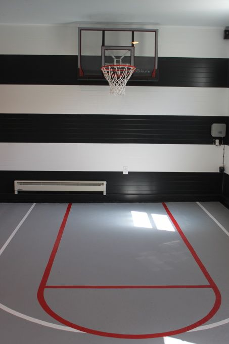 Garage turned playroom, We have 3 boys and they are very active.  We never parked in our garage so we wanted to make that square footage work for us.  So here you go..., We hung the basketball hoop & had the lines painted on the floor so they can take shots from different spots. , Garages Design