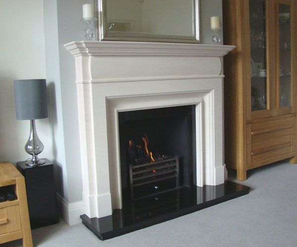 Bespoke Limestone fireplace surround Polished black granite slips and hearth Black metal chamber Amhurst polished gas coal fire Designed by Kent Fireplace Company Shown: Bespoke limestone fireplace surround, polished black granite slips & hearth, black metal fire chamber, polished Amhurst gas fire