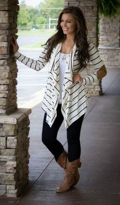 The perfect cardigan for jeans or leggings and boots! Our Go with The Flow Cardigan is sure to become a favorite. Featuring a flowing neckline, the trend of the season stripes and patchwork elbows, It