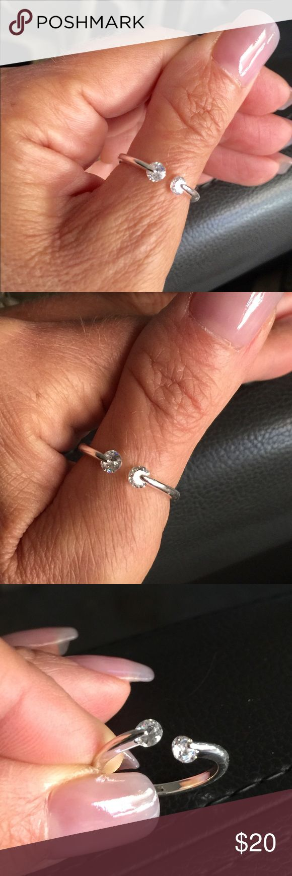 CZ Silver Plated Finger/Thumb Ring  CZ Silver Plated Finger/Thumb Ring Adjustable to fit approximately size 6 to 9. Jewelry Rings
