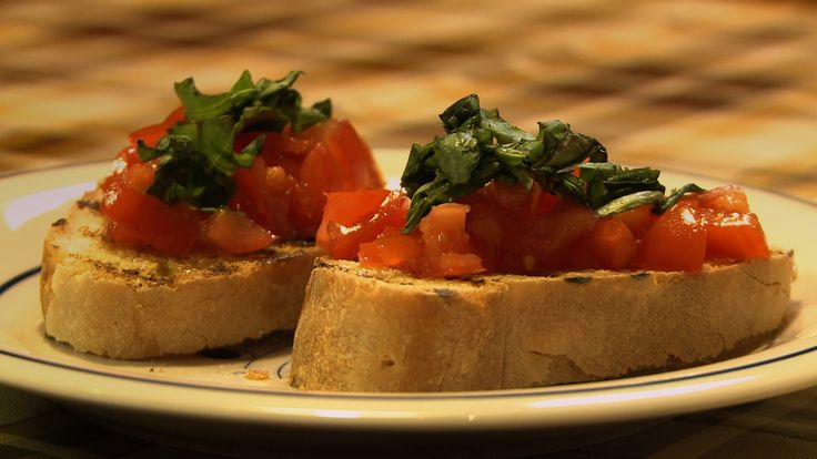 This is Italian bruschetta, freshly baked white crust bread, toasted to perfection, with fresh chopped tomatoes, extra-virgin olive oil and fresh Italian basil.