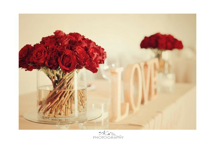 Simple but beautiful bridal table setting, shades of red, brown and cream