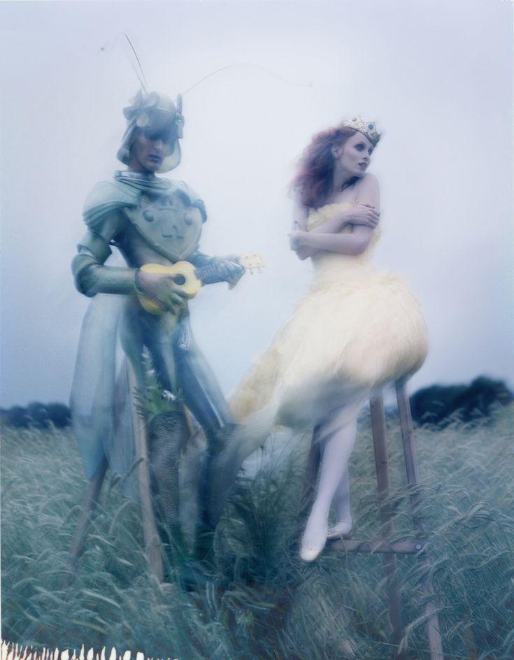 Karen Elson wears Alexander McQueen next to Gareth Pugh in a grasshopper costume, photographed by Tim Walker for Vogue UK December 2008.