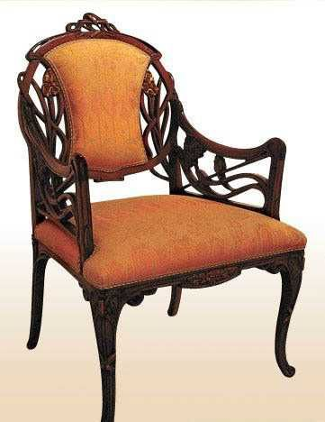 modern art nouveau furniture. chair design with carved wood details and orabge upholstery in modern style art nouveau furniture