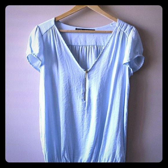 ZARA pastel blue slouchy top with zip Gently pre-loved. In very good condition. Slouchy textured fabric. The color is very light pastel blue with a slight shine to it- it looks so beautiful in person. Gold tone zip. Hem is elastic. Definitely a spring color! Zara Tops Blouses