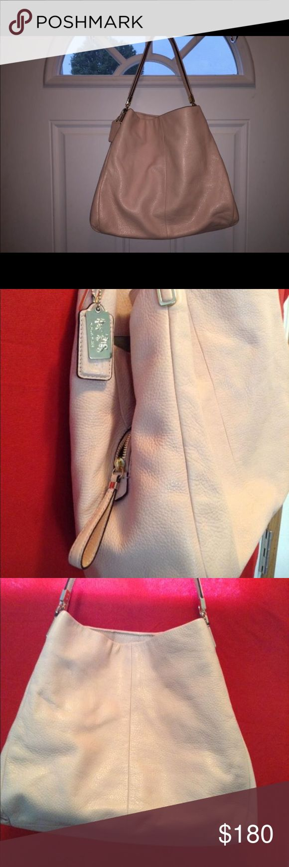 Coach Phoebe Leather in Blush - Like New! $558 Coach Phoebe Leather in Blush - Like New! $558 Retail. I purchased this bag from Coach in Key West. Not a factory bag. Excellent used condition. No stains or snags. No tarnish on any of the tags or zippers.  Huge - Large bag!  No dust bag. Coach Bags Shoulder Bags