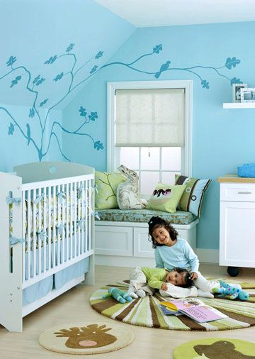 LOVE these colors, and the painted tree! I could SO do that!    A Calm and Collected Nursery  Treetop views, sky blue hues, plus style and storage aplenty -- together they hatch the perfect nest for an oh-so-modern baby.