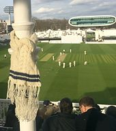 Ravelry: Cricket Sweater Cabled Scarf pattern by Miranda Jollie photographed at Lord's cricket ground, London.