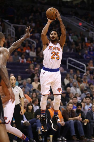 Derrick Rose #25 of the New York Knicks attempts a shot against the Phoenix Suns during the first half of the NBA game at Talking Stick Resort Arena on December 13, 2016 in Phoenix, Arizona. NOTE TO USER: User expressly acknowledges and agrees that, by downloading and or using this photograph, User is consenting to the terms and conditions of the Getty Images License Agreement.