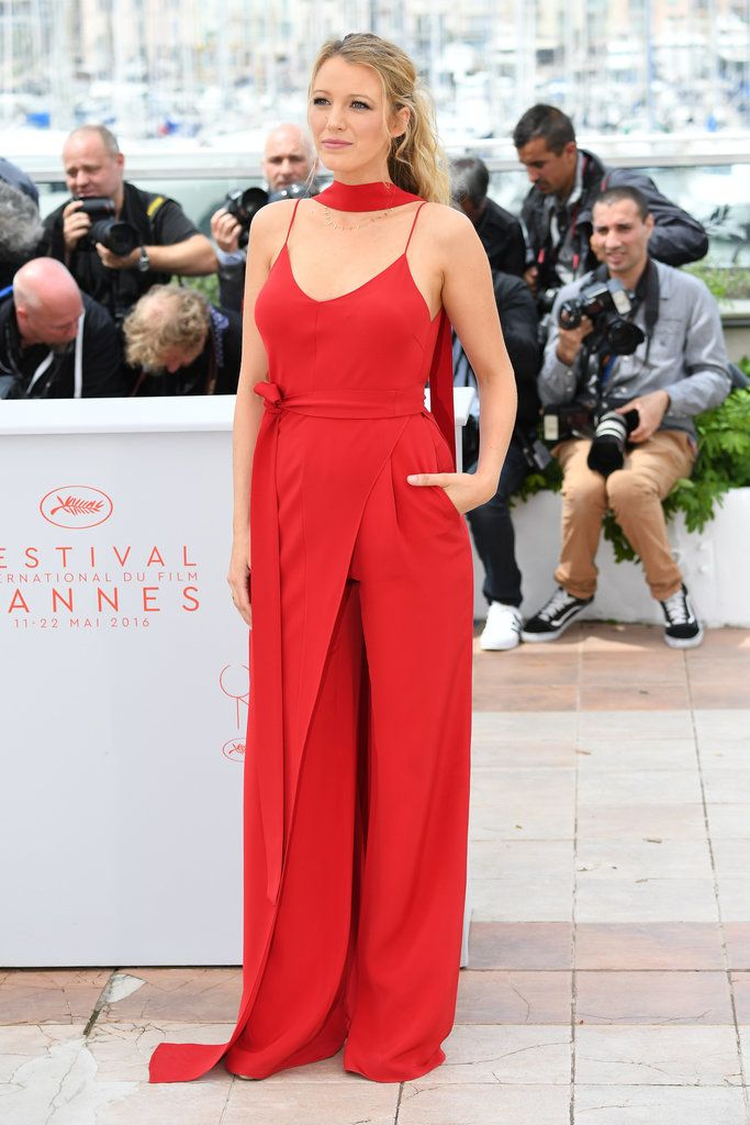 Blake Lively wearing a gorgeous red Juan Carlos Obando jumpsuit.