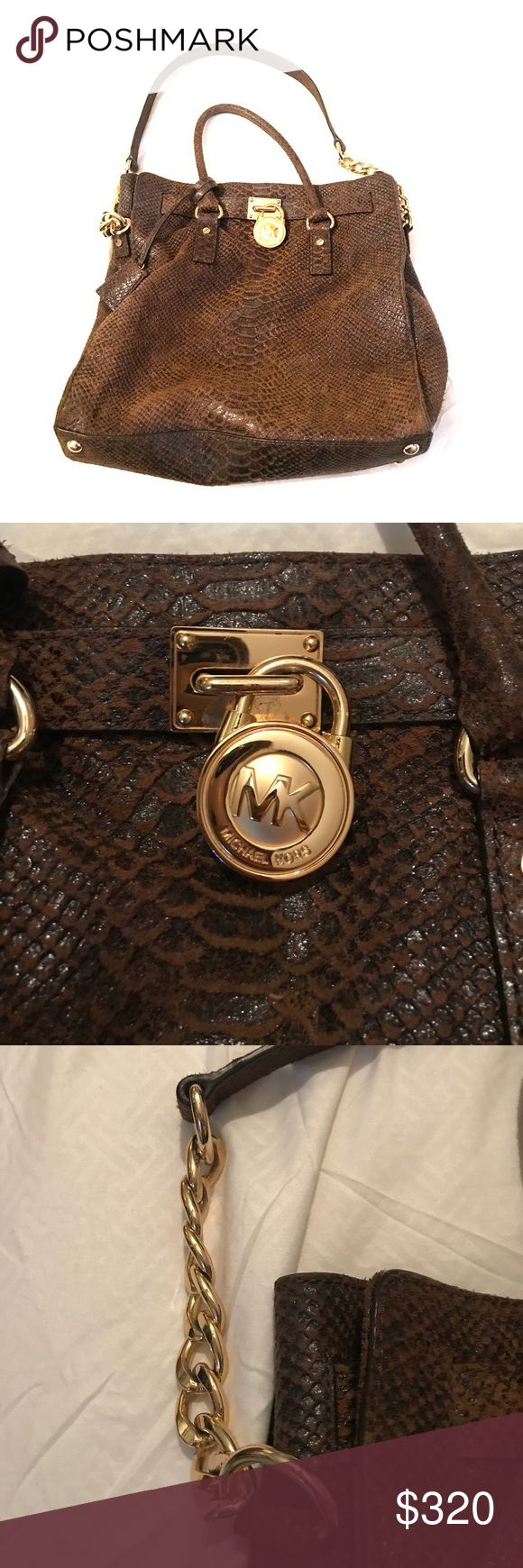 Michael Kors Snake Skin Suede Bag Authentic Michael Kors Snake Skin Suede Bag. Brown and Black Snake Skin! Fairly new! Small brown handle and long strap with gold chain!! Multiple pocket inside!! Signature Michael Kors pattern inside! No damage! Michael Kors Bags Shoulder Bags