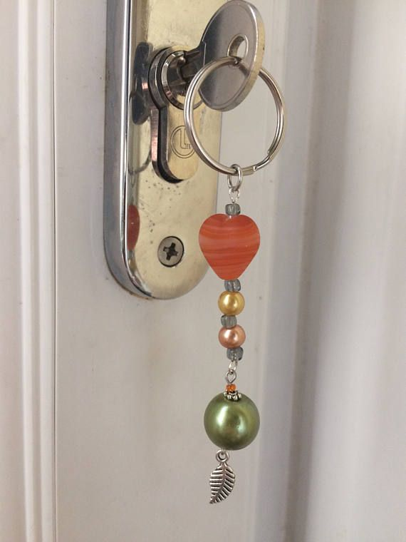 This unique keyring charm has been crafted to add a touch of colour and beauty to your keys or bag.  - Approximately 10cm long - Attaches by a 25mm split ring  It is also perfect to give as a beautiful gift to your best friend, a partner or a family member. Would do well for birthdays, celebrations and as a stocking filler.
