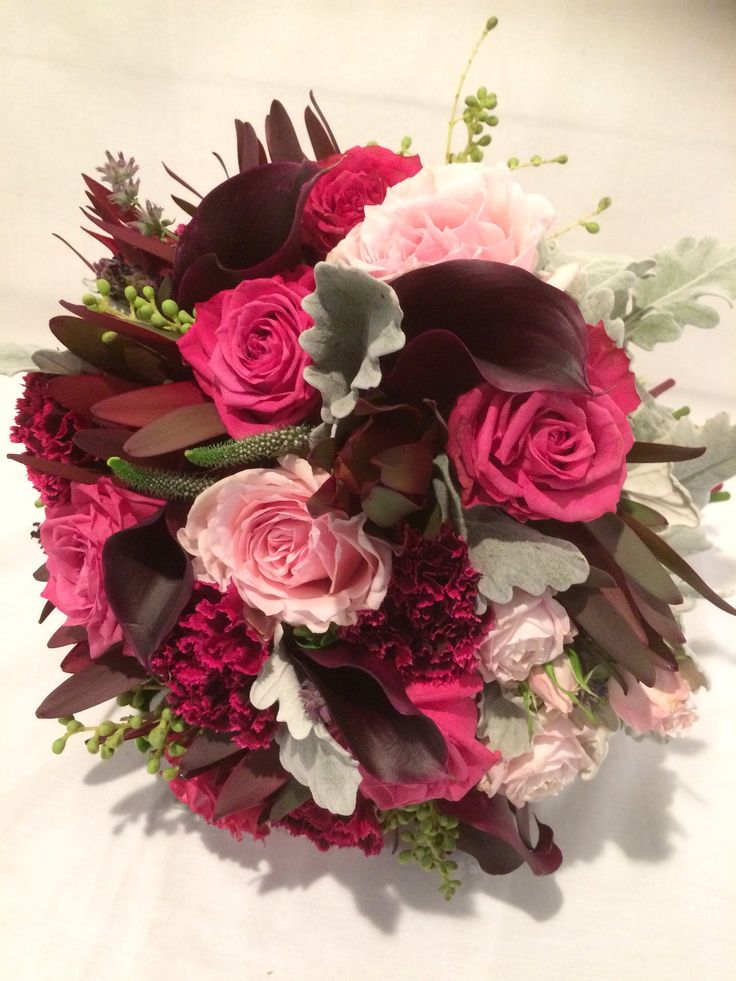 Plum mixed flower bouquet with silver suede foliage.