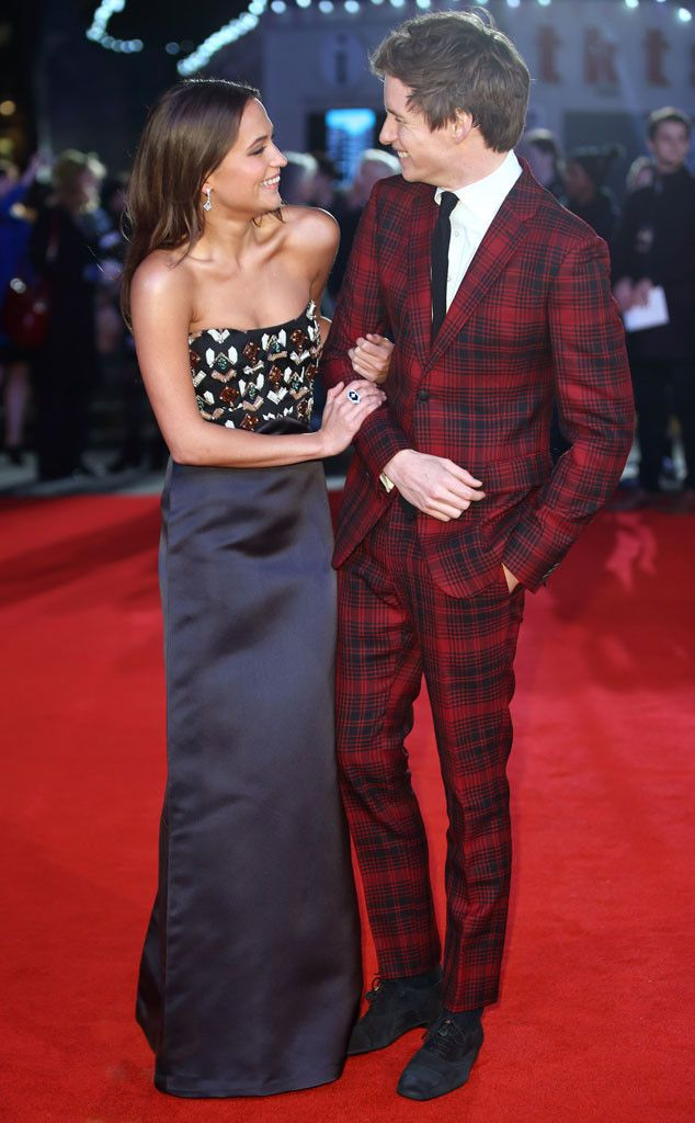 Alicia Vikander & Eddie Redmayne from Movie Premieres: Red Carpets and Parties!  The Danish Girl co-stars share a laugh at the film's London premiere.