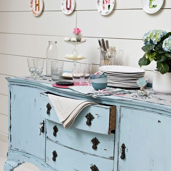 Although white is a key element of the style, soft pastel colours such as sky blue or pale pink also contribute to the look. This distressed sideboard in a soft duck-egg blue has been piled with vintage china for a relaxed and pretty feel.