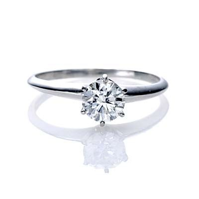 Simple Engagement Ring. Perfection. But I like the princess cut diamond .