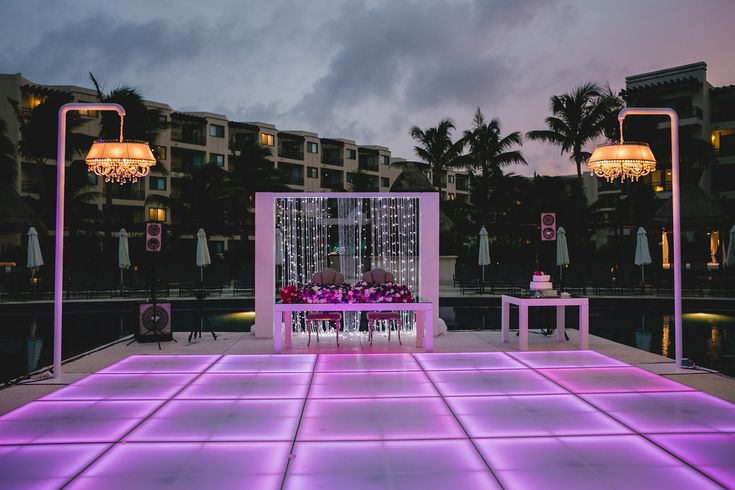 An LED dance floor is a great way to light up your reception as the sun goes down. #DreamsRivieraCancun