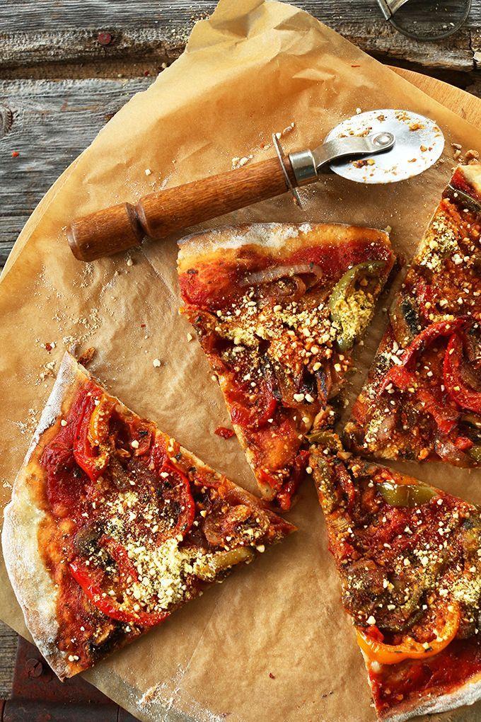 THEE BEST Vegan Pizza! Sauteed veggies, simple tomato sauce, loads of vegan parmesan cheese. Pizza perfection! #vegan #pizza http://minimalistbaker.com/my-favorite-vegan-pizza/