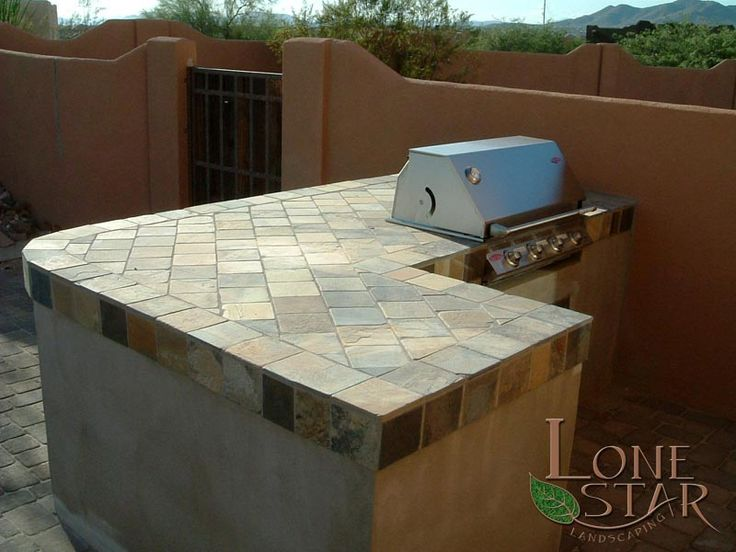 This Barbecue Island Has A Large Slate Tile Countertop In