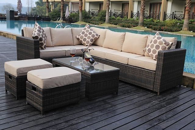 L Shaped Rattan Garden Sofa Set With Table And Stools Set Up By The Pool Side Brown Garden Sofa Set Outdoor Patio Furniture Sets Outdoor Sofa Sets