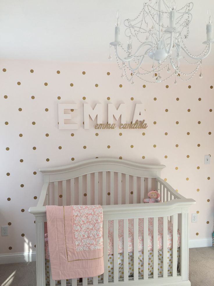 Baby girl nursery. Name over the crib. Bridal Pink Benjamin Moore wall color. Pink and gold polka dot decal walls from Urban Wall Decals. Pottery Barn Kids chandelier.