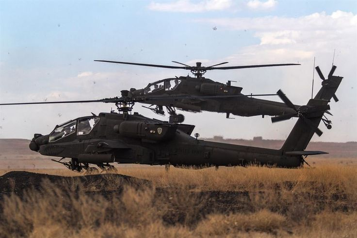 Two AH-64E Apache helicopters prepare to land at Orchard Combat Training Center, Idaho, Sept. 29, 2016. Army photo by Capt. Brian Harris