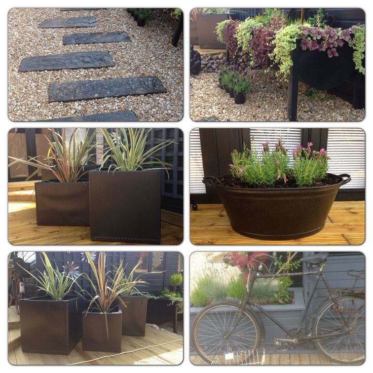 Love these reclaimed loft water tanks tin bath and old cattle water trough makes stunning planters