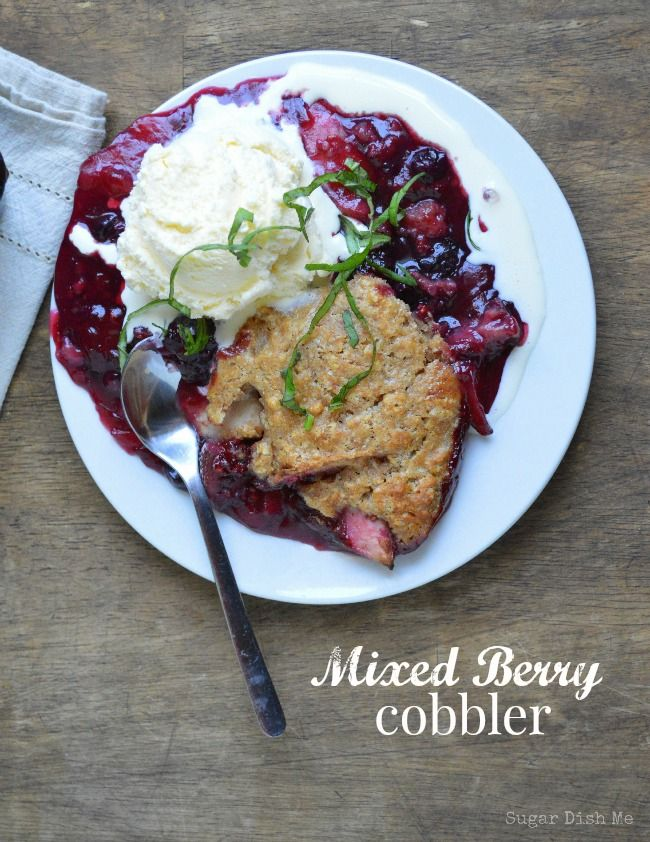 Mixed Berry Cobbler on www.sugardishme.com  Berries, apples, and a whole wheat almond crust! Helloooo gorgeous summer dessert!