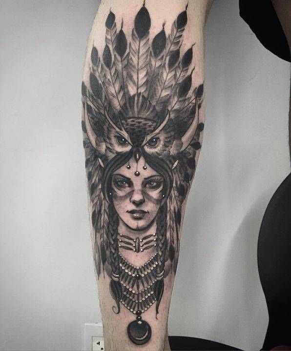 Female native American chief tattoo on the left calf.