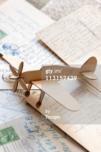 Carboard airplane on postcards