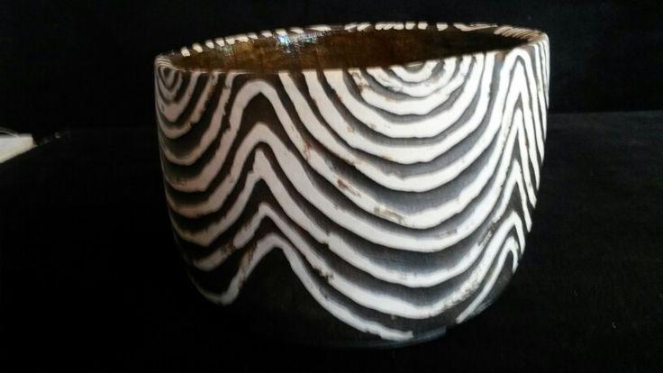 Utensil holder by Natasha Viljoen. Shellac resist with clay erosion and painted slip. Earth Play Studio.