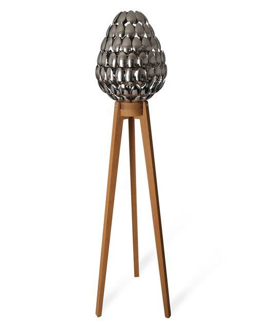 UK-based designer Clive Roddy designed this lamp with a lampshade made of spoons. Inspired by pinecones (clever!) when took a visit to Yosemite National Park, Roddy thought he'd try to translate it into a lamp with 115 stainless steel desert spoons.