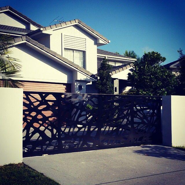 Driveway Gates : Private Residence Brisbane Urban Metal Design : Branches Material : Powder coated aluminium  Electronic Sliding Gate