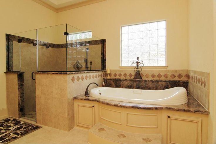 Mediterranean Master Bathroom with Crown molding, Belle 44 x 78 Oval Drop-In Bathtub, frameless showerdoor, Drop-In Bathtub