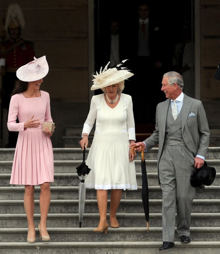 whatekatewore:  Duchess of Cambridge and father-in-law the Prince of Wales share a smile along with the Duchess of Cornwall at the Queen's Garden Party, May 29, 2012; PA Wire