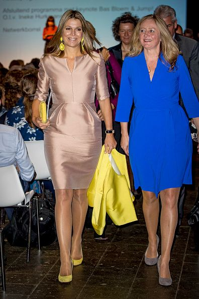 (L) Dutch Queen Maxima's satin dress flattered her figure and bought out her eyes. She donned a bright yellow jacket with matching heels and giant earrings, as she attended a conference for Gender and Health of Women in Amersfoort in the Netherlands.