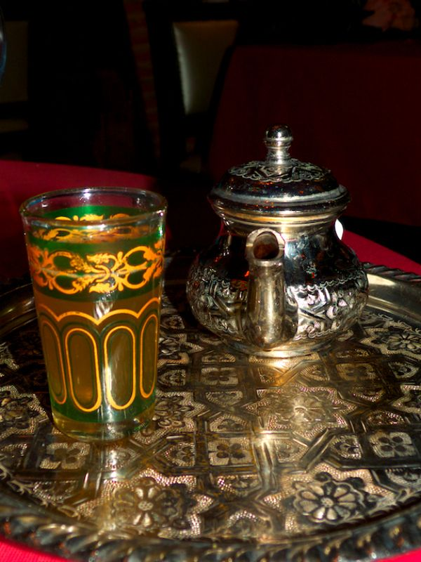 Moroccan Mint tea - the three key ingredient are green tea. lots of sugar lumps and a whole bunch of fresh mint with stems in the tea top. Sweet and delicious!