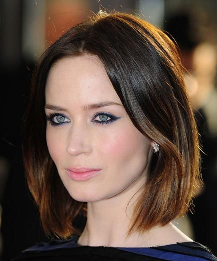 Looking elegant as always, Emily rocks a beautifully colored blunt bob. Because the tips are lighter, this look plays up her eyes without having bangs. #EmilyBlunt #OvalFace #Hairstyles
