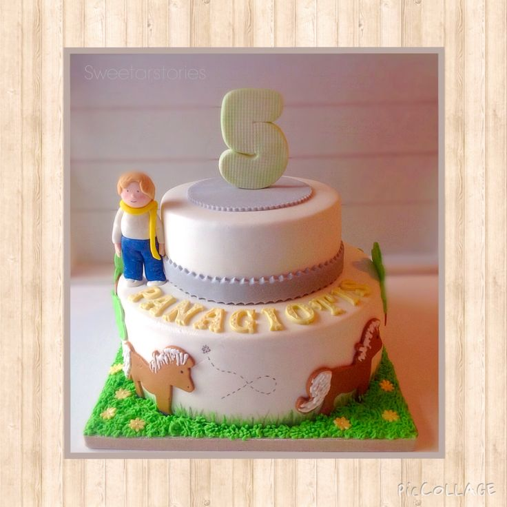 For a boy who loves horses!!2-tiered vanilla cake with vanilla buttercream .