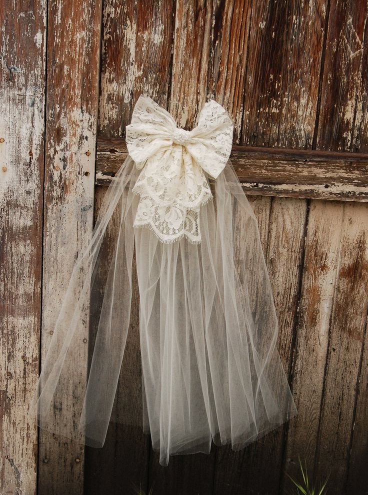 "Ivory or White Lace Bow with veil on a clear comb, matches ""Olga"" and ""Petra"" flower girl dress. First Communion veil."