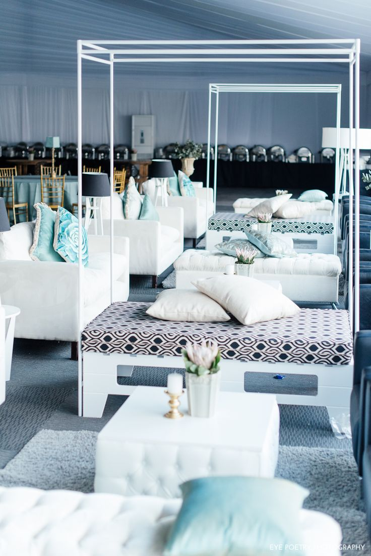 Sea foam and white furniture setup by GRAND ROOM DESIGN