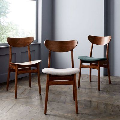 Choose multiple colors of the same chair design as a playful-but-modern way to add color to a dining space.