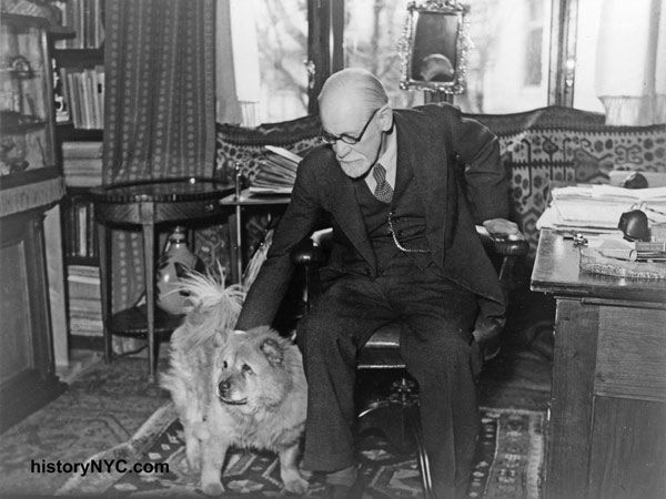 Sigmund Freud in his study with his dog, Jo-Fi, 1937. Freud felt that dogs had a special sense that allows them to judge a person's character accurately.