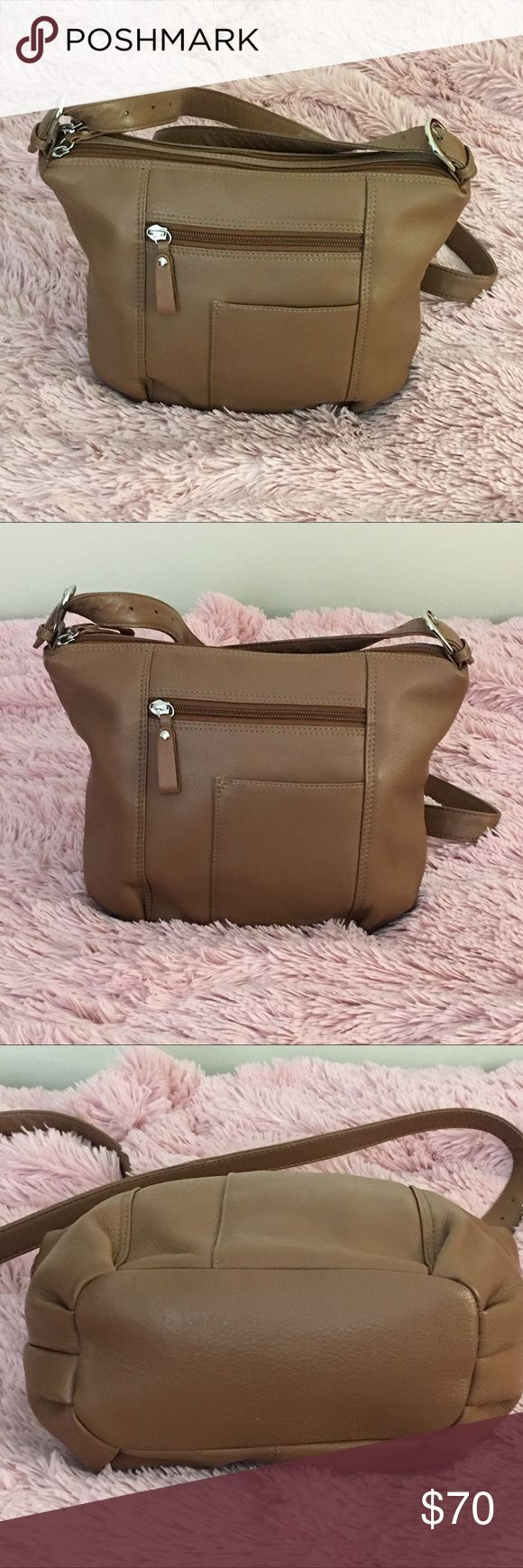 ili New York genuine leather Crossbody bag 💼 Like new use few times perfect for traveling so soft lather 3 Big bucketswith zipper and 2 wallet holder and cell phone buckets feel free to make offer ili nwe york Bags Crossbody Bags
