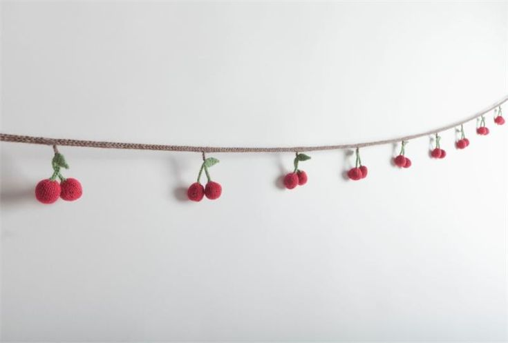 cherry garland. you could do this with pompoms!