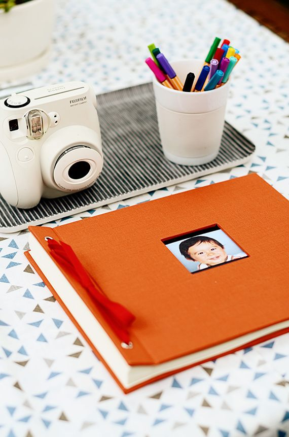 Buy polaroid camera and colorful markers  (from Theo's Say Cheese 1st birthday | 100 Layer Cakelet)