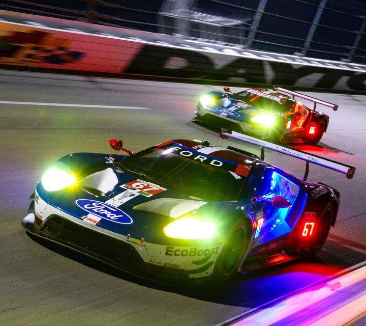 Two Ford G T Vehicles On Racetrack At Night Ford Gt Ford Sport Ford Sports Cars